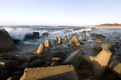 Concrete pieces on beach. Jumbled pieces of concrete along an ocean beach Royalty Free Stock Photography