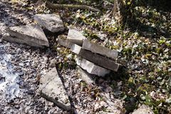 Concrete pieces for garden path. Repair works in the garden. Nature and concrete royalty free stock photography
