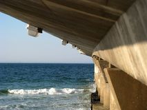 Concrete pier at beach. A concrete pier at the beach showing the architectural design Royalty Free Stock Images