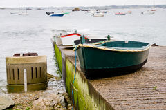 Concrete pier and boat in Brittany Stock Photo