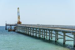 Pier with construction crane in Shabla Royalty Free Stock Photography
