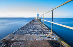 Serene harbour pier Stock Photo