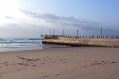 Concrete Pier Protruding from Sea at Low Tide Royalty Free Stock Photos
