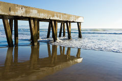 Concrete pier and reflection Stock Photo
