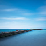Concrete pier, rocks and sea on sunset. White beach, Tuscany, It Royalty Free Stock Photography