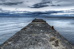 Concrete pier and the sea on the eve of the storm Royalty Free Stock Image