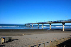 Concrete pier at town New Brighton beach Stock Photos