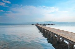 Concrete pier in the water with light sky. In Ohrid,Macedonia Stock Photo