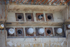 Concrete piles in a construction area Royalty Free Stock Photos