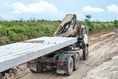 Concrete piles on a trailer royalty free stock image