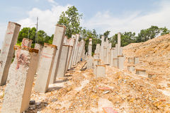 Concrete piling bars pounded into ground at construction site Stock Image