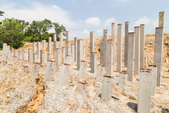 Concrete piling bars pounded into ground at construction site Stock Photography
