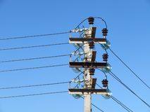 Concrete pillar with insulators. And wires stock photos