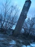 Concrete pillar. Old forgotten rural architecture background. Nature landscape royalty free stock image