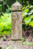 Concrete Pillar in orchard Stock Photography