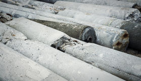 Concrete pillars on the ground. Concrete structure damaged. Stock Photo