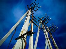 Concrete pillars of high-voltage line stock photography