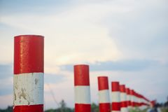 Concrete pillars isolated unique photo. Beautiful red and white concrete pillars beside a road unique photo stock images