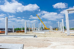 Concrete pillars of new edifice with a beautiful sky are placed Stock Images