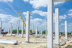 Concrete pillars of new edifice with a beautiful sky are placed. Architecture concept, concrete skeleton of a new edifice is ready for next step against blue Stock Image