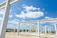 Concrete pillars of new edifice with a beautiful sky are placed Royalty Free Stock Photo