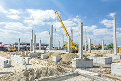 Concrete pillars of new edifice with a beautiful sky are placed Stock Photos