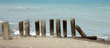 Concrete pillars on seashore royalty free stock image