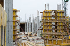Concrete Pillars Supported With Boards on Construction Site Stock Photo