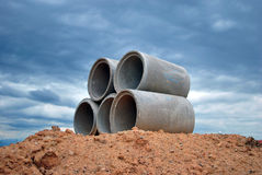 Concrete pipe and the rain cloud. In my backyard Royalty Free Stock Photos