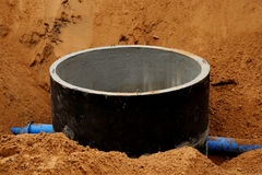 Concrete pipe in sand Royalty Free Stock Photo