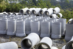 Concrete pipe. Stack of concrete pipe in construction site stock photo