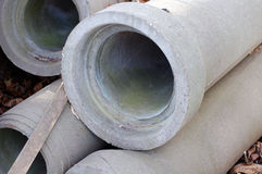 Concrete pipes. Collection of concrete pipes stacked outdoors royalty free stock photography