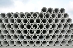 Concrete pipes stack. Many reinforced concrete pipes waiting for use Stock Photography