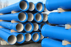 Concrete pipes for transporting water and sewerage. Piles of concrete blue pipes for transporting water and sewerage Stock Photo