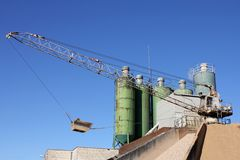 Concrete plant. Against blue sky stock photos