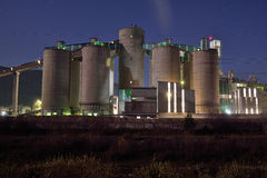 Concrete plant silos by night Royalty Free Stock Image