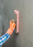 Concrete plaster cleaning. By sponge in construction site royalty free stock images