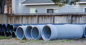 Concrete and Plastic Pipe on Site Stock Photo