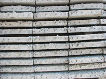 Concrete plates for the floor. Side view of concrete plates for the device of a strong floor Royalty Free Stock Photo
