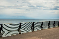 Concrete platform with railings at Youghal seafront Royalty Free Stock Photography