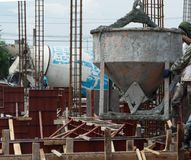 Concrete pouring during commercial concreting floors of building Royalty Free Stock Photos