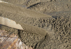 Concrete pouring during commercial concreting floors of building. S in construction Stock Image