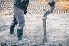 Concrete pouring during commercial concreting floors of building. S in construction - concrete slab Stock Image