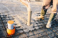 Concrete pouring during commercial concreting floors of building. S in construction - concrete slab Stock Photos