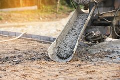 Concrete pouring during commercial concreting floors of building. On green background Royalty Free Stock Photography