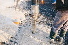 Concrete pouring during commercial concreting floors of building. S in construction site - concrete slab Royalty Free Stock Images