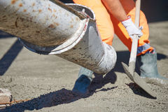 Concrete pouring during commercial concreting floors of building Stock Photos