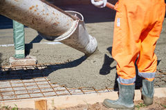 Concrete pouring during commercial concreting floors of building Royalty Free Stock Photo