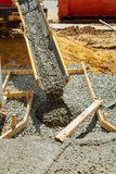 Concrete pouring during commercial concreting floors of buildings construction. Concrete pouring during commercial concreting floors of buildings in construction Stock Images