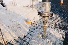 Concrete pouring during commercial concreting floors of building. S in construction - concrete slab Royalty Free Stock Photo